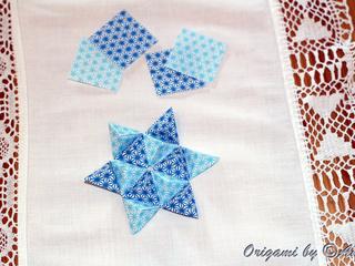 Star of pyramids origami mosaic by Annette Bussmann