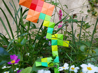 Origami spring flower in the garden by Elsa