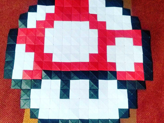 Super Mario Mushroom in origami pixels made by Henry Triana