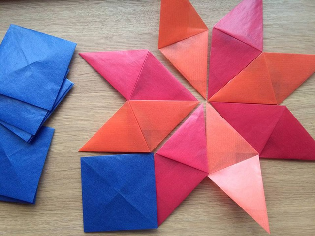 Origami pixels and trixels wind rose star in the making.