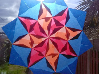 Wind Rose Star Translucent Origami Mosaic by Michaela Bertsch