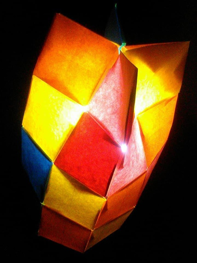 Origami lampshade with light.