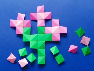 Pink flowers origami pixels mosaic