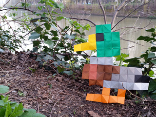 Origami pixels duck spotted near the river